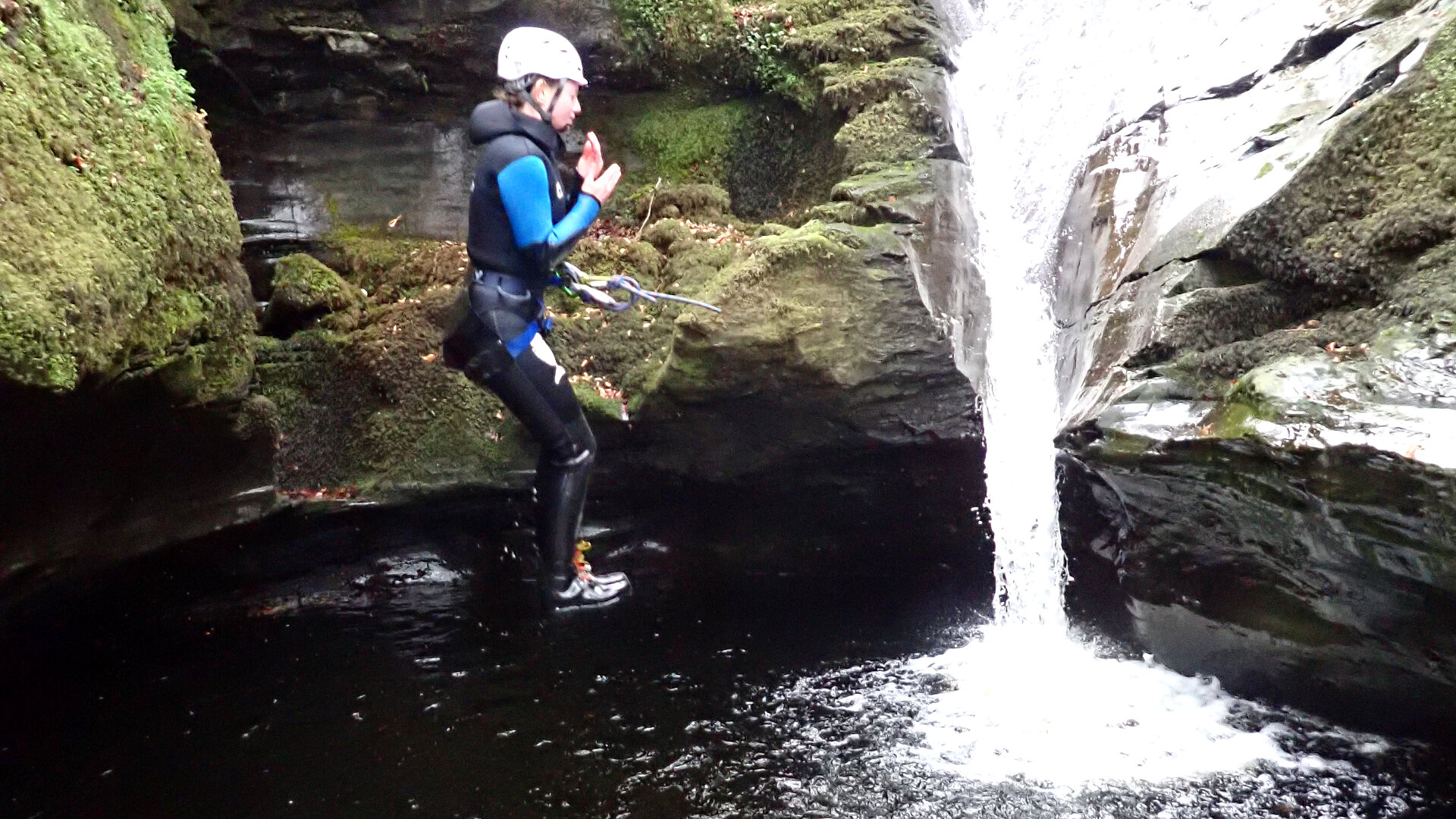 canyoneer jumping into plung pool