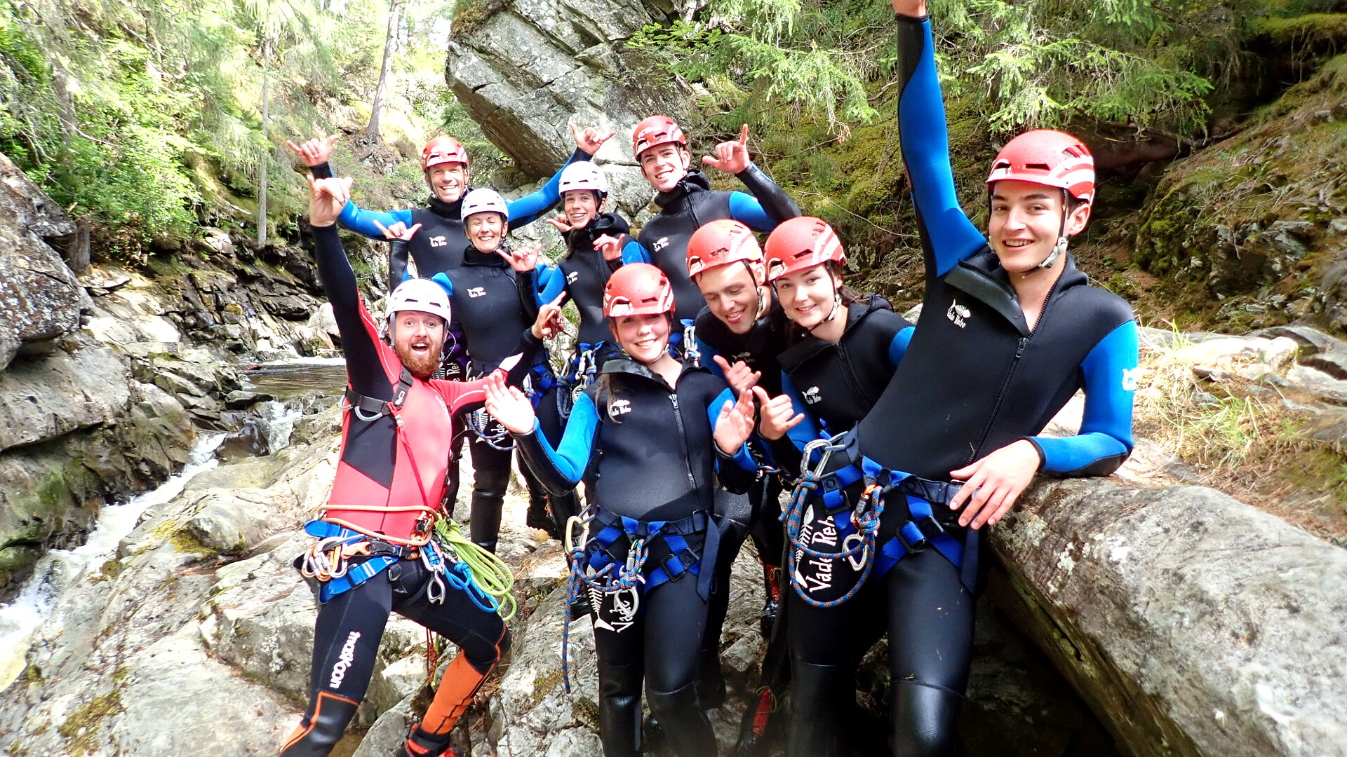 Group of gorge walkers celebrating after trip