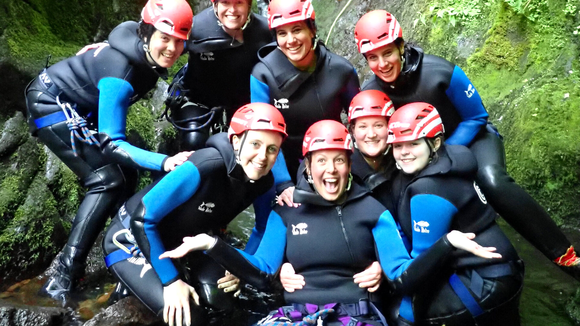 Group of women on hen party trip at base of gorge