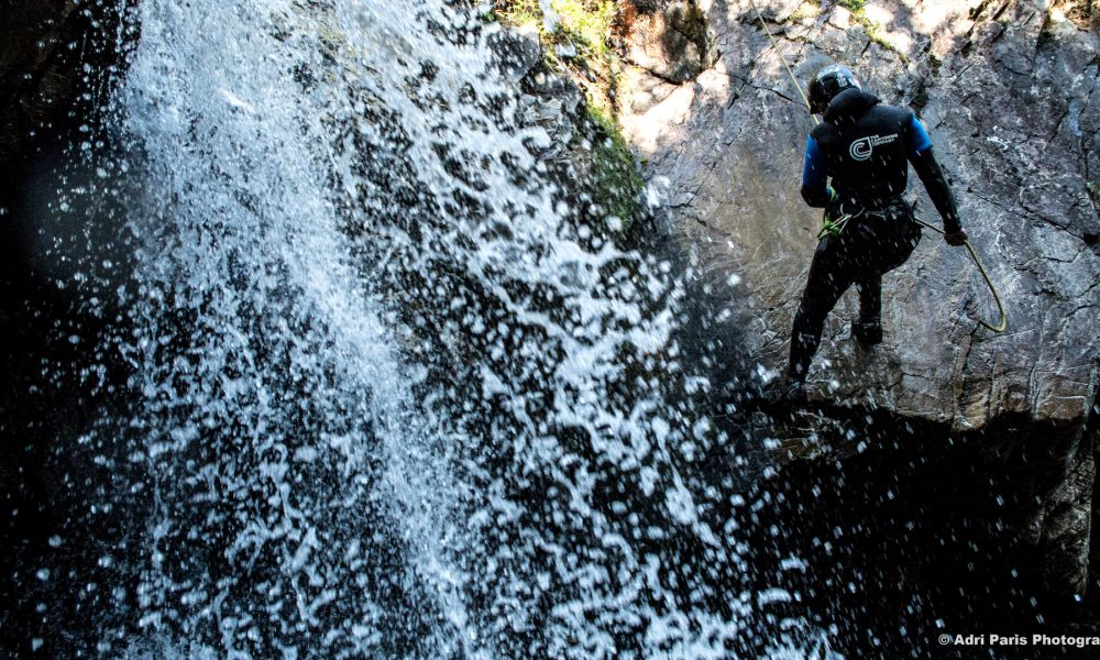 canyoneer abseiling down inchree canyon