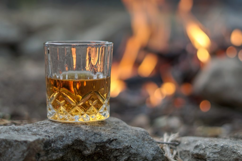 Whiskey round a fire