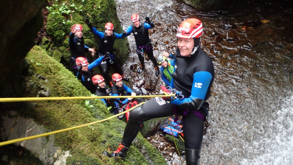 Canyonneer abseiling down Waterfall and cliff