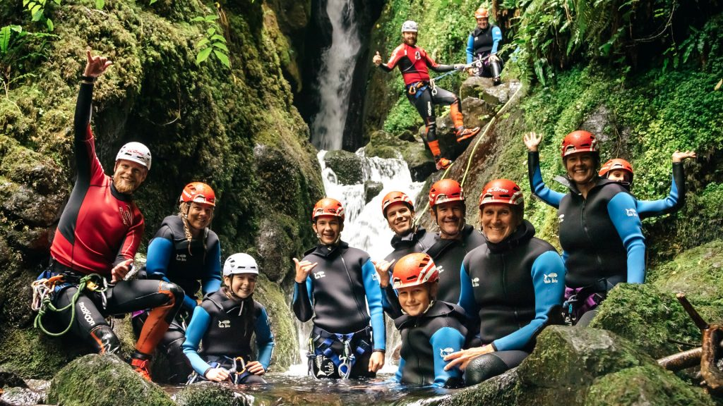 Canyoning group on trip at bottom of dollar gorge waterfall