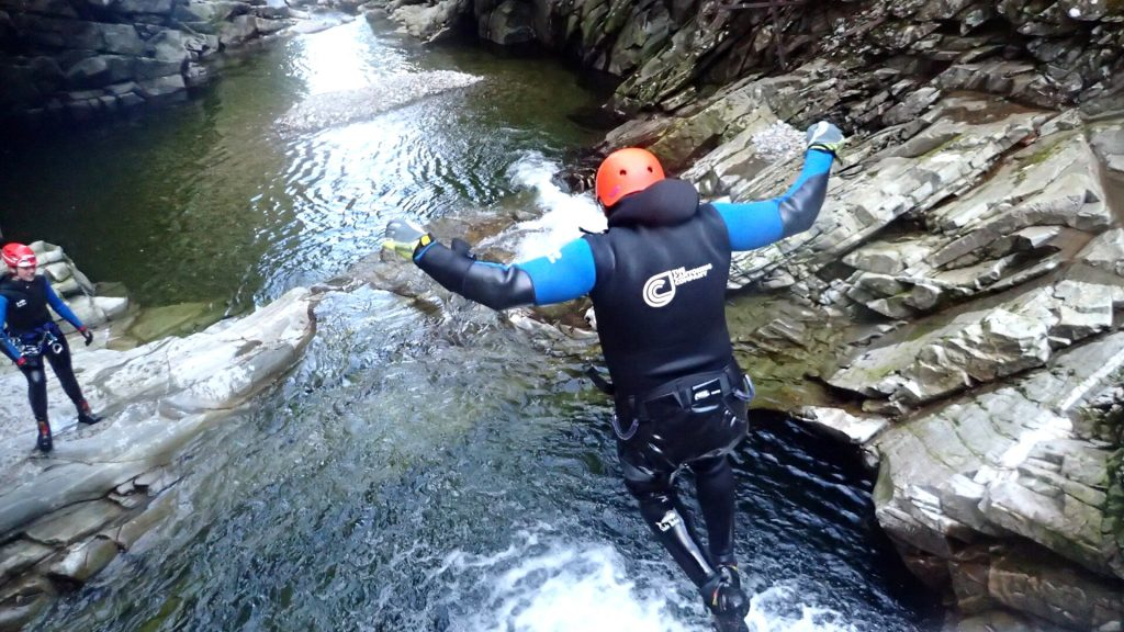Man Jumping into pool on a Gorge Walking Trip
