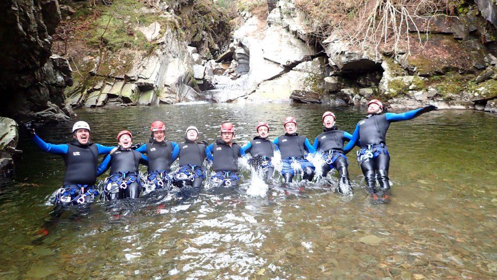 Group of Gorge Walkers floating in rock pool