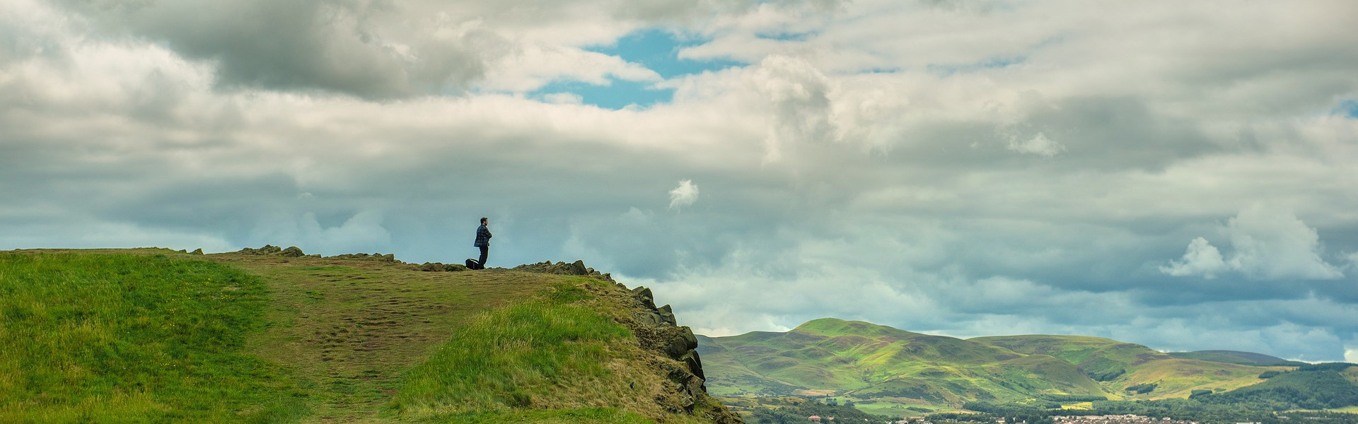 Man on hill overlooking Edinburgh